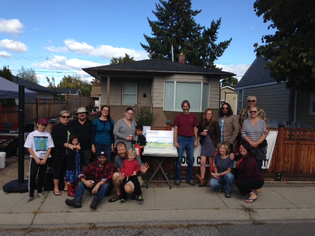 NSG Project in South Okanagan. A group of people gathered in front of a home posing for a photo.